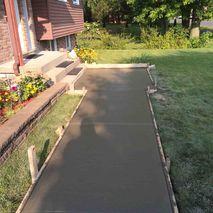 newly constructed cement layer in front of house